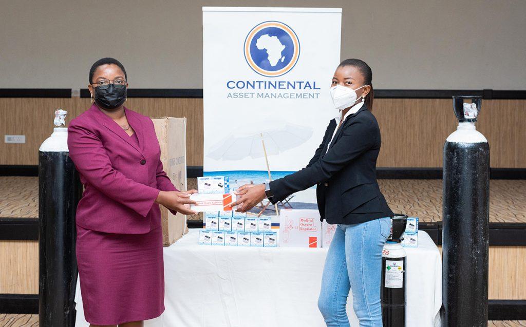 CAM CEO Mrs Gilllian Kachikondo making a symbolic handover to SMD representative Dr. Winnie Mhone